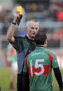 14 February 2010; Referee, Jimmy White, issues a Yellow card to Mayo's Mark Ronaldson, after a late incident. Allianz National Football League, Division 1, Round 2, Tyrone v Mayo, Healy Park, Omagh, Co. Tyrone. Picture credit: Oliver McVeigh / SPORTSFILE *** Local Caption ***