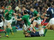 13 February 2010; Ireland's Jamie Heaslip receives the ball from team-mate Stephen Ferris, who is tackled by Lionel Nallet, France. RBS Six Nations Rugby Championship, France v Ireland, Stade de France, Saint Denis, Paris, France. Picture credit: Brian Lawless / SPORTSFILE *** Local Caption ***