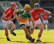 21 February 2010; Ger Oakley, Offaly, in action against Mark O'Sullivan, left, and Patrick Horgan, Cork. Allianz GAA Hurling National League Division 1 Round 1, Cork v Offaly. Pairc Ui Chaoimh, Cork. Picture credit: Ray McManus / SPORTSFILE