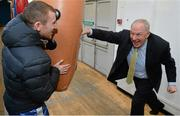 9 March 2016; Michael Ring, T.D., Minister of State for Tourism & Sport, hits a punching bag held by Irish boxer Paddy Barnes at the IABA High Performance Squad before a training session to mark 150 days to go to the Rio 2016 Olympic Games. National Boxing Stadium, Dublin. Picture credit: Cody Glenn / SPORTSFILE