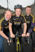 23 February 2010; The All-Ireland winning Kilkenny hurling squad, along with past players, and Ireland's top handballers, are preparing to don a jersey of a different nature on Saturday the 6th of March - taking to the roads of Kilkenny for a thirteen stage cycle around Kilkenny City to raise money for Enable Ireland. The Cats pedalling line up includes current stars such as Henry Shefflin and Tommy Walsh, as well as former giants of the game DJ Carey, Joe Hennessy and Noel Skehan. The event has been organised by Kilkenny handball legend Michael 'Ducksy' Walsh, who amassed and incredible 38 All-Ireland senior titles. Still playing at the top levels of the sport, Ducksy now dedicates much of his time to charity fundraising. The event is also being supported by the GAA and by the Irish Handball Council. At the announcement of the final route for the cycle are Hurling All-Star of the Year Kilkenny's Tommy Walsh, with former Kilkenny hurler Joe Hennessy, left, and Kilkenny handball legend Michael 'Ducksy' Walsh, right. Enable Ireland, O'Neill Centre, St. Joseph's Road, Kilkenny. Picture credit: Brian Lawless / SPORTSFILE