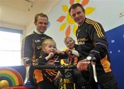 23 February 2010; The All-Ireland winning Kilkenny hurling squad, along with past players, and Ireland's top handballers, are preparing to don a jersey of a different nature on Saturday the 6th of March - taking to the roads of Kilkenny for a thirteen stage cycle around Kilkenny City to raise money for Enable Ireland. The Cats pedalling line up includes current stars such as Henry Shefflin and Tommy Walsh, as well as former giants of the game DJ Carey, Joe Hennessy and Noel Skehan. The event has been organised by Kilkenny handball legend Michael 'Ducksy' Walsh, who amassed and incredible 38 All-Ireland senior titles. Still playing at the top levels of the sport, Ducksy now dedicates much of his time to charity fundraising. The event is also being supported by the GAA and by the Irish Handball Council. At the announcement of the final route for the cycle are Hurling All-Star of the Year Kilkenny's Tommy Walsh, left, and Kilkenny handball legend Michael 'Ducksy' Walsh, with Aine Alyward, age 4, from Knocktopher, Kikenny, and Kyle Gallagher, age 3, from Ballyragget, Kilkenny. Enable Ireland, O'Neill Centre, St. Joseph's Road, Kilkenny. Picture credit: Brian Lawless / SPORTSFILE
