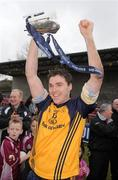 27 February 2010; Paddy Andrews, DCU, celebrates with the Sigerson Cup. Ulster Bank Sigerson Cup Final, Dublin City University v University College Cork, Leixlip GAA Club, Leixlip, Co. Kildare. Picture credit: Pat Murphy / SPORTSFILE