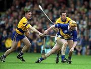6 May 2001; Eamonn Corcoran, Tipperary, in action against James O'Connor, left, and Tony Griffin, Clare, Tipperary v Clare, Allianz National Hurling League Final, Gaelic Grounds, Limerick. Picture credit; Brendan Moran / SPORTSFILE