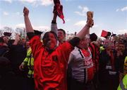 6 May 2001; Bohemians fans celebrate after hearing Shelbourne were defeated in Tolka Park, their victory over Kilkenny City lead to them being eircom league Champions, eircom league premier division, Kilkenny City v Bohemians, Soccer, Buckley Park, Co. Kilkenny. Picture credit; Matt Browne / SPORTSFILE