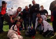 6 May 2001; Bohemians fans watch the final moments of the Shlebourne v Cork City game on a portable television. Kilkenny City v Bohemians, eircom League, Premier Division, Buckley Park, Kilkenny. Soccer. Picture credit; Matt Browne / SPORTSFILE