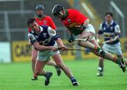 29 April 2001; Cyril Cuddy, Laois in action against Michael Slye, Carlow, Guinness Leinster hurling Championship, Carlow v Laois, Dr Cullen Park, Co. Carlow. Picture credit; Damien Eagers / SPORTSFILE