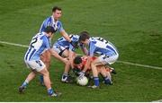 17 March 2016; Ballyboden St Endas players, from left, Bob Dwan, Shane Durkin, Darragh Nelson and Robbie McDaid, surround Neil Lydon, Castlebar Mitchels. AIB GAA Football All-Ireland Senior Club Championship Final, Ballyboden St Endas, Dublin, v Castlebar Mitchels, Mayo. Croke Park, Dublin. Picture credit: Piaras Ó Mídheach / SPORTSFILE