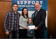 17 March 2016; GAA Vice President and Chairman of Leinster Council John Horan presents Tom Geoghegan – Eire Og, Carlow, represented by his son-in-law Gary Powell, Ciara Geoghegan and Juliette Powell, with a shopping voucher to the value of €1,000 at a retailer of his choice. during the presentation of prizes to the winners of the GAA National Club Draw. Nally Suite, Croke Park, Dublin. Picture credit: Ray McManus / SPORTSFILE