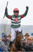 18 March 2016; Jockey Noel Fehily celebrates as he enters the winners' enclosure after winning the Albert Bartlett Novices' Hurdle on Unowhatimeanharry. Prestbury Park, Cheltenham, Gloucestershire, England. Picture credit: Cody Glenn / SPORTSFILE