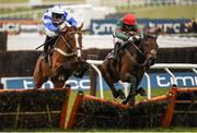 18 March 2016; Unowhatimeanharry, right, with Noel Fehily up, jumps the last alongside Fagan, with Davey Russell up, who finished second, on their way to winning the Albert Bartlett Novices' Hurdle. Prestbury Park, Cheltenham, Gloucestershire, England. Picture credit: Cody Glenn / SPORTSFILE