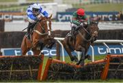 18 March 2016; Unowhatimeanharry, right, with Noel Fehily up, jumps the last alongside Barters Hill, with David Bass up, on their way to winning the Albert Bartlett Novices' Hurdle. Prestbury Park, Cheltenham, Gloucestershire, England. Picture credit: Cody Glenn / SPORTSFILE