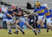 14 March 2010; Iarla Tannian, Galway, in action against Paddy Stapleton, left, and Shane McGrath, Tipperary. Allianz GAA Hurling National League, Division 1, Round 3, Tipperary v Galway, Semple Stadium, Thurles, Co. Tipperary. Picture credit: Brian Lawless / SPORTSFILE