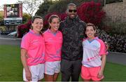 19 March 2016; Former Miami Dolphin NFL football player  Roberto Wallace with Kerry All Stars, from left, Caroline Kelly, Aislinn Desmond and Sarah Houlihan, after the game. TG4 Ladies Football All-Star Tour, 2014 All Stars v 2015 All Stars. University of San Diego, Torero Stadium, San Diego, California, USA. Picture credit: Brendan Moran / SPORTSFILE