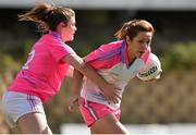 19 March 2016; Caroline O'Hanlon, Armagh and 2014 All Stars, in action against Marie Ambrose, Cork and 2015 All Stars. TG4 Ladies Football All-Star Tour, 2014 All Stars v 2015 All Stars. University of San Diego, Torero Stadium, San Diego, California, USA. Picture credit: Brendan Moran / SPORTSFILE