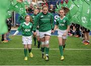 20 March 2016; Ireland captain Niamh Briggs leads out her team with mascots Katie Cashman, from Mullinahone, Co. Tipperary, left, and Lucy Collins, from Lucan, Co. Kildare, right. Women's Six Nations Rugby Championship, Ireland v Scotland. Donnybrook Stadium, Donnybrook, Dublin. Picture credit: Seb Daly / SPORTSFILE