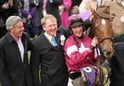 17 March 2010; Michael O'Leary, left, member of the winning connections of Weapon's Amnesty with trainer Charles Byrnes and jockey Davey Russell after winning the RSA Chase. Cheltenham Racing Festival - Wednesday. Prestbury Park, Cheltenham, Gloucestershire, England. Picture credit: Paul Mohan / SPORTSFILE