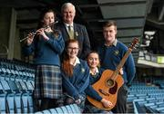 """22 March 2016; """"Song to Commemorate 1916"""", a competition organised by the GAA National Scór Committee for Second Level Schools as its contribution to 1916. Students from Coláiste Bhríde Carnew, Co. Wicklow, who were winners of the GAA Scór Song to Commemorate 1916 Competition. Pictured with Uachtarán Chumann Lúthchleas Aogán Ó Fearghail are students, from left, Fiona Doyle, Jacqui Whelan, Ciara Jordan, and Paddy Doyle. Croke Park, Dublin. Picture credit: Paul Mohan / SPORTSFILE"""