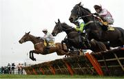 18 March 2016; A general view of runners and riders in the the JCB Triumph Hurdle including, from right, Who Dares Wins, with Richard Johnson up, Clan Des Obeaux, with Noel Fehily up, and Let's Dance, with Paul Townend up. Prestbury Park, Cheltenham, Gloucestershire, England. Picture credit: Cody Glenn / SPORTSFILE