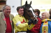 18 March 2016; Jack Sherwood with winning owners John and Pat Hales in the parade ring after winning the Martin Pipe Conditional Jockeys' Handicap Hurdle on Ibis Du Rheu. Prestbury Park, Cheltenham, Gloucestershire, England. Picture credit: Cody Glenn / SPORTSFILE