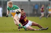 27 March 2016; Niall Darby, Offaly, in action against Denis Corroon, Westmeath. Allianz Football League Division 3 Round 6, Westmeath v Offaly. TEG Cusack Park, Mullingar, Co. Westmeath. Picture credit: Seb Daly / SPORTSFILE