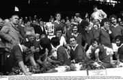 5 September 1976; Cork captain Ray Cummins prepares to make his speech after being presented with the Liam MacCarthy Cup by GAA President Con Murphy. Also pictured are , from left, Cork County Board Chairman Donal O'Sullivan, Pat McDonnell, John Horgan, Martin O'Doherty, Charlie McCarthy, 13, Martin Coleman, goalkeeper, Denis Coughlan, Gerald McCarthy, Brian Murphy, Eamonn O'Donoghue, Sean O'Leary, John Allen and Mick Malone. All Ireland Senior Hurling Championship Final, Cork v Wexford, Croke Park, Dublin. Picture credit; Connolly Collection / SPORTSFILE