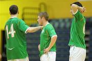 30 March 2010; Dejected Republic of Ireland players, from left to right, Stephen Murphy, Philip McDonagh and Jack Doyle after their side's defeat. International Futsal Friendly, Republic of Ireland v Norway, National Basketball Arena, Tallaght, Dublin. Picture credit: Paul Mohan / SPORTSFILE