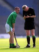 5 May 2001; Brian Carey, St. Colman's Fermoy is booked by referee Pat Aherne, Gort Community School v St Colman's, Fermoy, All-Ireland Colleges Senior 'A' Hurling Final, Croke Park, Dublin. Hurling. Picture credit; Ray McManus / SPORTSFILE