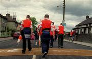 20 May 2001; Armagh fans walk through disinfectant mats on their way to the Bank of Ireland Ulster Senior Football Championship Quarter-Final match between Tyrone and Armagh at St Tiernach's Park in Clones, Monaghan. Photo by Damien Eagers/Sportsfile