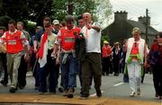 20 May 2001; Armagh fans walk through disinfectant mats on their way to the Bank of Ireland Ulster Senior Football Championship Quarter-Final match between Tyrone and Armagh at St Tiernach's Park in Clones, Monaghan. Photo by David Maher/Sportsfile