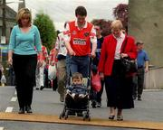 20 May 2001; Armagh fans walk through disinfectant mats prior to the Bank of Ireland Ulster Senior Football Championship Quarter-Final match between Tyrone and Armagh at St Tiernach's Park in Clones, Monaghan. Photo by David Maher/Sportsfile