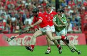 27 May 2001; Cork's Wayne Sherlock is tackled by Mark Keane, Limerick. Cork v Limerick, Munster Senior Hurling Championship, Pairc Ui Chaoimh, Cork. Picture credit; Ray McManus / SPORTSFILE