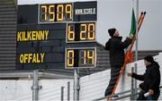3 April 2016; With the scoreboard to his left Kilkenny groundsman Timmy Grogan lowers the Tricolour, which had flown at half mast in honour of the late Jim McGrath, after the game. Allianz Hurling League Division 1 Quarter-Final, Kilkenny v Offaly. Nowlan Park, Kilkenny. Picture credit: Ray McManus / SPORTSFILE