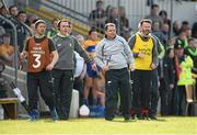 3 April 2016; The Clare backroom team, from left to right, coach Aengus O'Brien, selector Louis Mulqueen, manager Davy Fitzgerald, and selector Donal Og Cusack look on as Aaron Shanagher goes through before scoring their second goal. Allianz Hurling League Division 1 Quarter-Final, Clare v Tipperary. Cusack Park, Ennis, Co. Clare. Picture credit: Diarmuid Greene / SPORTSFILE