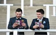 6 April 2016; Donal McDermott, a student at DIT, and Jason Moore, who studies at Maynooth University, study race cards ahead of the races. Leopardstown, Co. Dublin. Picture credit: David Fitzgerald / SPORTSFILE