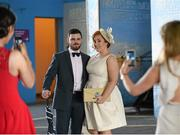 6 April 2016; Donal McDermott, who studies at DIT, and Isabelle McCarthy, who studies in St Patrick's College, have their photos taken by friends ahead of the races. Leopardstown, Co. Dublin. Picture credit: David Fitzgerald / SPORTSFILE