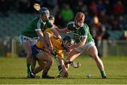 6 April 2016; Kieran Galvin, Clare, in action against Brian Nash, left, and Conor Nicolas, Limerick. Electric Ireland Munster GAA Hurling Minor Championship, Quarter-Final, Limerick v Clare. Gaelic Grounds, Limerick. Picture credit: Diarmuid Greene / SPORTSFILE
