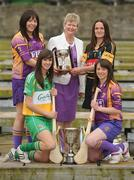 19 April 2010; At a captain's day photocall ahead of the 2010 National Camogie League Division 1 and 2 Finals, Division 1 captains Una Leacy, back left, Wexford, and Anne Dalton, Kilkenny with Joan O'Flynn, President, Cumann Camogaiochta na nGael and Division 2 captains Michaela Morkan, front left, Offaly, and Ciara O'Connor, Wexford. Both finals take place in Semple Stadium, Thurles, on Saturday next, 24th April, with the Division 2 Final at 2pm and the Division 1 Final at 4pm. Maldron Hotel, Grand Canal, Dublin. Picture credit: Brendan Moran / SPORTSFILE