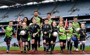 12 April 2016; TV star Moone Boy, David Rawle, joined a host of GAA stars today at Croke Park to launch Kellogg's GAA Cúl Camps 2016. The summer camps attract over 100,000 children and are hosted in more than 1,000 locations nationwide. Costing just Ä55 for a full week of fun, coaching and a free kit, Kellogg's is on a mission for the promotion of nutrition coupled with physical activity. Sign up for Kellogg's GAA Cúl Camps at www.kelloggsculcamps.gaa.ie. Pictured are Cork camogie player Aisling Thompson, Mayo footballer Aidan O'Shea, Kilkenny hurler TJ Reid and Armagh ladies footballer Aimee Mackin with children from Gaelscoil Choláiste Mhuire. Croke Park, Dublin. Picture credit: Ramsey Cardy / SPORTSFILE