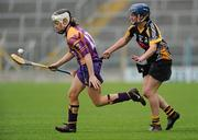 24 April 2010; Kate Kelly, Wexford, in action against Ann Dalton, Kilkenny. Division 1 Camogie National League Final, Offaly v Wexford, Semple Stadium, Thurles, Co. Tipperary. Picture credit: Brian Lawless / SPORTSFILE