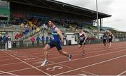16 April 2016; Andrew Mellon, Queens University Belfast, on his way to winning the Mens 100M relay event. Irish Universities Athletic Association Track & Field Championships 2016, Day 1. Morton Stadium, Santry, Co. Dublin. Picture credit: Oliver McVeigh / SPORTSFILE