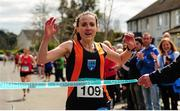 17 April 2016; Carol Costello, from Slí Cualann AC, Co. Wicklow, crosses the line to win the Master Women's relay race, during the Glo Health AAI National Road Relays. Raheny, Dublin. Picture credit : Tomás Greally / SPORTSFILE