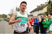 17 April 2016; Daire Bermingham, Raheny Shamrock AC, Dublin, crosses the line to win the Senior Men's relay race, during the Glo Health AAI National Road Relays. Raheny, Dublin. Picture credit : Tomás Greally / SPORTSFILE