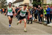17 April 2016; Mick Clohisey, left, hands the baton over to Daire Bermingham, right, Raheny Shamrock AC, Dublin, on the final leg`, on their way to winning the Senior Men's relay race. The Glo Health AAI National Road Relays. Raheny, Dublin. Picture credit : Tomás Greally / SPORTSFILE
