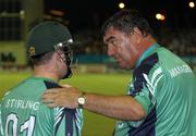 30 April 2010; Manager Roy Torrens has words of encouragement for opening batsman Paul Stirling. 2010 Twenty20 Cricket World Cup Group Stages, Ireland v West Indies, Providence Stadium, Guyana. Picture credit: Handout / Barry Chambers / RSA / Cricket Ireland Via SPORTSFILE
