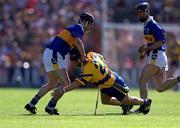 3 June 2001; Clare's Gearoid Considine gets the ball away despite the attentions of Tipperary's Thomas Costello. Tipperary v Clare, Munster Hurling Championship, Pairc Ui Chaoimh, Cork. Picture credit; Brendan Moran / SPORTSFILE