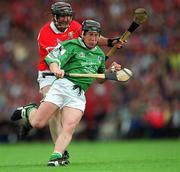 27 May 2001; James Butler, Limerick, in action against Brian Corcoran, Cork. Cork v Limerick, Munster Senior Hurling Championship, Pairc Ui Chaoimh, Cork. Picture credit; Ray McManus / SPORTSFILE