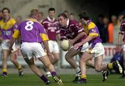 9 June 2001; Westmeath's Ger Heavin in action against Wexford's Colm Morris and Willie Carley (8). Wexford v Westmeath, All-Ireland Football Championship Qualifier Round 1, Wexford Park, Wexford. Picture credit; Brendan Moran / SPORTSFILE *(EDI)*