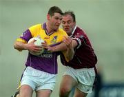 9 June 2001; Wexford's Pat Forde holds off the challenge of Westmeath's Ger Heavin. All-Ireland Football Championship Qualifier, Round 1, Wexford Park, Wexford. Picture credit; Brendan Moran / SPORTSFILE