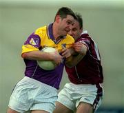 9 June 2001; Pat Forde, Wexford in action against Ger Heavin, Westmeath. Wexford v Westmeath, Leinster Senior Football Championship, Wexford Park, Wexford. Picture credit; Brendan Moran / SPORTSFILE